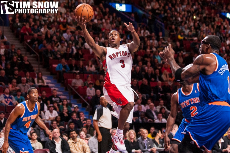 Kyle Lowry charges the net