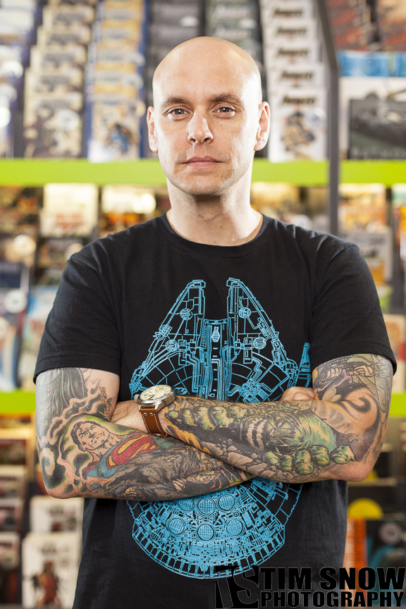 Jason Rockman, singer for the Slaves On Dope and DJ for Montreal radio station CHOM, poses for a portrait at LaSalle's Expert Comics during a photo shoot for Skin Deep Magazine. PHOTO BY TIM SNOW